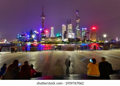 Beijing, China - October28, 2019:Local and tourists relaxing and sightseeing at Huangpu riverside The Bund in Shanghai, China