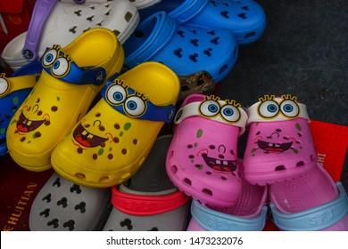 Beijing China on July 11, 2010. Spongbob quake pants crocs sold at a market in China. Illustrative editorial.