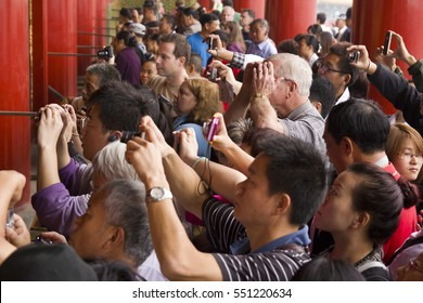 BEIJING, CHINA - SEPTEMBER 13, 2011: Unidentified people taking pictures of one of the large interior spaces inside the Forbidden City in Beijing at September 13, 2011