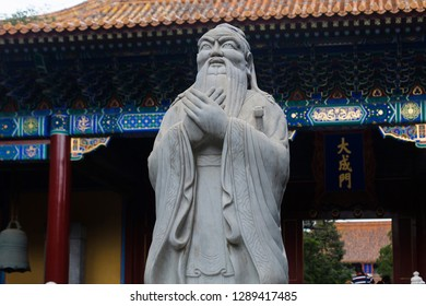 Beijing / China - September 2016: A sculpture of Confucius inside a building of the Beijing Temple of Confucius complex.
