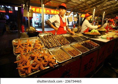 Beijing, China - September 24, 2014: A vendor sells food at the Donghuamen night market in Beijing, China.