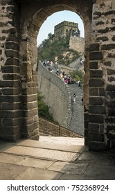 Beijing, China – September 25, 2017: Great Wall of China through one of the towers arched doorways. It is major landmark and historical tourist attraction in Beijing, China