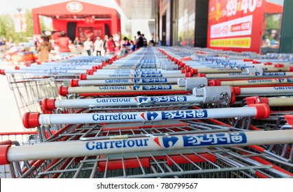 BEIJING, CHINA-APRIL 22, 2017: Dozens of shopping carts are seen outside a Carrefour store at city downtown; Carrefour S.A is a French multinational retailer founded in 1958 and serves worldwide.