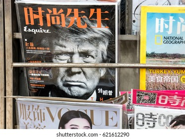 BEIJING, CHINA-APRIL 7, 2017: USA President Donald Trump is seen at the cover of a magazine at a news stand. The first meeting between Trump and President of China Xi Jinping was held on April 6.