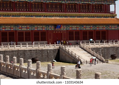 BEIJING, CHINA-AUGUST 5, 2010: Despite the strong heat in Beijing in August, thousands of tourists visit the Forbidden City each day, shielding the sun with umbrellas on August 5, 2010