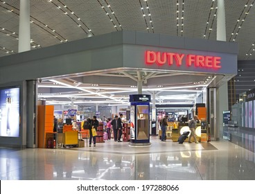 BEIJING, CHINA-JAN.23, 2014: People is seen in a Duty free shop at Beijing Capital International Airport. As of 2014, this airport is the busiest airport in the world in terms of passenger throughput