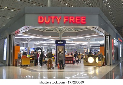 BEIJING, CHINA-JAN.23, 2014: People seen at a Duty free shop at Beijing Capital International Airport. As of 2014, this airport is the busiest airport in the world in terms of passenger throughput
