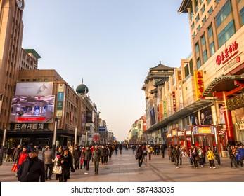 BEIJING, CHINA-January 25, 2012: Crowds of people in wangfujing shopping street of Beijing