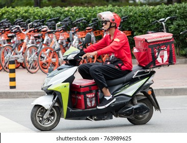 BEIJING, CHINA-JULY 22, 2017: A Baidu Waimai Food delivery service driver is seen at city downtown; Baidu Waimai food delivery service has more than 100 million active users monthly.