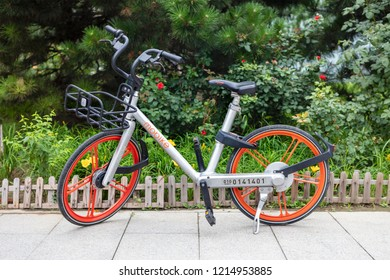 BEIJING, CHINA-JULY 22, 2017: A Mobike bicycle is seen on city downtown. Mobike was created by Beijing Mobike Technology Co., Ltd. It is the largest shared (for  hire) bicycle operator in the world