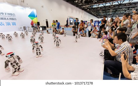 BEIJING, CHINA-JULY 8, 2017: Visitors enjoy a Robots performance during the 3E Beijing International Consumer Electronics Expo 2017.
