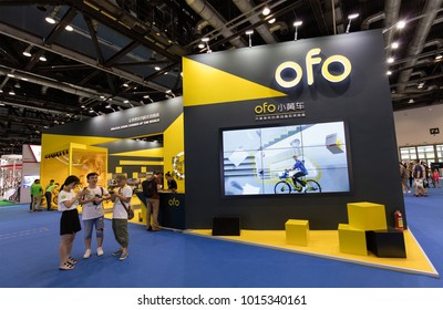 BEIJING, CHINA-JULY 8, 2017: Visitors are seen at the Ofo booth during the Beijing International Bicycle & Spare Parts Exhibition 2017. Ofo is a Beijing-based bike-sharing company founded in 2014.