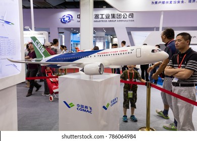 BEIJING, CHINA-JUN 10, 2017: Visitors are sen around a mockup of the jumbo jet C919 of the Commercial Aircraft Corporation of China (COMAC) at the China Beijing International High-tech Expo 2017.