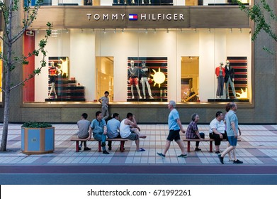 BEIJING, CHINA-JUN 4, 2017: Unidentified people is seen next to a Tommy Hilfiger store. Tommy Hilfiger is a global apparel and retail company founded in 1985.