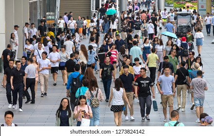 BEIJING, CHINA-JUNE 3, 2017: Unidentified people crowd Xidan commercial area. Xidan is a traditional commercial area located in Xicheng District and it occupies around 80 hectares.