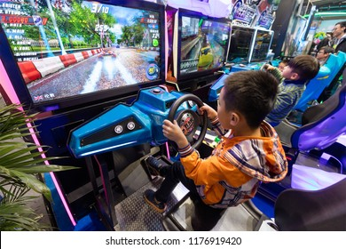 BEIJING, CHINA-MARCH 18, 2017: Children play arcade games during the China (Beijing) Attractions Expo