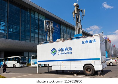 BEIJING, CHINA-MARCH 26, 2017: China Mobile logo is seen on a Mobile communications vehicle. China Mobile, founded in 1997, is the world's largest mobile phone operator by subscribers