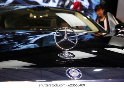 Beijing, China-May 1, 2014: Mercedes Benz logo close up. Mercedes-Benz is a German automobile manufacturer. The brand is used for luxury automobiles, buses, coaches and trucks.