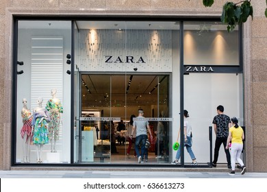 BEIJING, CHINA-MAY 1, 2017: People walk in a Zara store. Zara is one of the largest international fashion companies and it's the flagship chain store of the Inditex group.