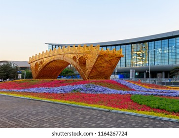 "BEIJING, CHINA-MAY 11, 2017: ""Golden Bridge on Silk Road"" sculpture is on display at the Olympic Green ahead of the upcoming Belt and Road Forum for International Cooperation."