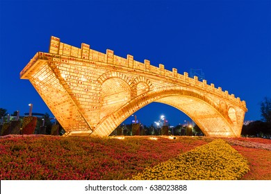 """BEIJING, CHINA-MAY 11, 2017: """"Golden Bridge on Silk Road"""" sculpture is on display at the Olympic Green ahead of the upcoming Belt and Road Forum for International Cooperation."""