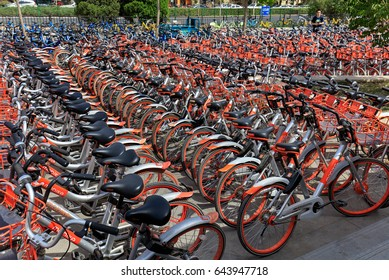 BEIJING, CHINA-MAY 12, 2017: Dozens of Mobike bicycles are parked next to a subway station exit in city downtown. Mobike was created by Beijing Mobike Technology Co., Ltd. is a bicycle-sharing system