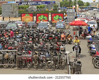 BEIJING, CHINA-MAY. 14, 2011: A rider is seen at a parking lot on Zhongguancun area.  China's bicycle production increased by 1.9% to 24.17 million units from January to May this year.