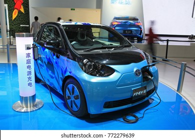 BEIJING, CHINA-MAY 2, 2012: A Toyota FT-EV III is connected to an electric charging station at the 2012 Beijing International Automotive Exhibition (Auto China 2012)