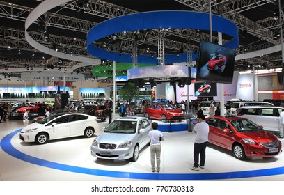 BEIJING, CHINA-MAY 2, 2012:  Unidentified people are seen at the Toyota booth at the 2012 Beijing International Automotive Exhibition (Auto China 2012)