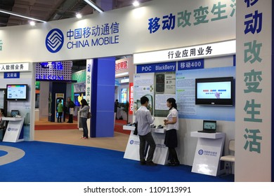 BEIJING, CHINA-MAY 20, 2011:   Unidentified people are seen at the China Mobile booth during the 14th China Beijing International High-tech Expo (CHITEC)