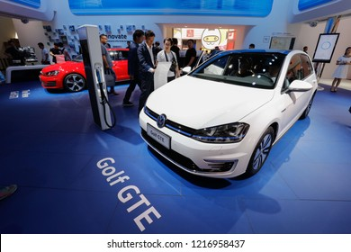 BEIJING CHINA-May 3, 2016: At the Beijing International Automobile Exhibition, staff show the charging interface of the imported Volkswagen Golf GOLF GTE hybrid vehicle.Golf is the best seller of VW.