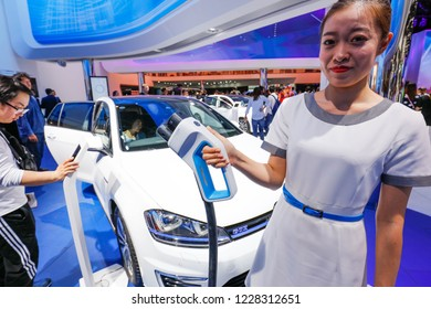 BEIJING CHINA-May 3, 2016: At the Beijing International Automobile Exhibition, staff show the charging interface of the imported Volkswagen Golf GOLF GTE hybrid vehicle.Green energy vehicle.