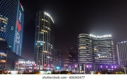BEIJING, CHINA-NOVEMBER 19, 2016:  Sanlitun SOHO is seen at night. Sanlitun SOHO was designed by Japanese architect Kengo Kuma.
