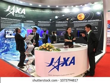 BEIJING, CHINA-SEPTEMBER 23, 2013: Unidentified people are seen at the Japan Aerospace Exploration Agency (JAXA) booth during the 64th International Astronautical Congress (IAC 2013).