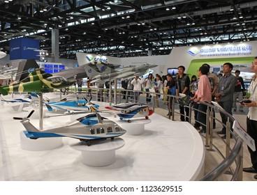 BEIJING, CHINA-SEPTEMBER 25, 2013: Visitors take a look of aircraft mockups of the Aviation Industry Corporation of China, Ltd. (AVIC) on display during 15th Aviation Expo/China at China National Conv