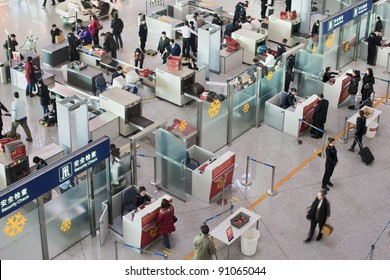 BEIJING - DEC. 16. Security check area at Beijing Capital Airport. The airport registered 488,495 aircraft movements (take-offs + landings), ranked 10th in the world. Beijing, Dec. 16, 2011.