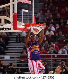 BEIJING - DECEMBER 13 : Bam Bam Bamiro of the Harlem Globetrotters dunks the ball during the Harlem Globetrotters 2009 China Tour Show at the Wukesong Arena on December 13, 2009 in Beijing, China.