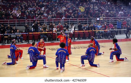 BEIJING - DECEMBER 13 : Harlem Globetrotters show their skills during the Harlem Globetrotters 2009 China Tour Show at the Wukesong Arena on December 13, 2009 in Beijing, China.