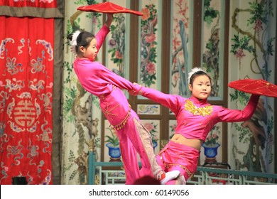 BEIJING - DECEMBER 3: Chinese children perform acrobatics onstage at Prince Gong's palace on 3 December, 2009 in Beijing, China