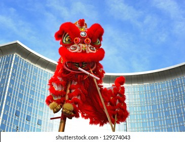 BEIJING - FEB 11: participants perform the dragon and lion dance during Chinese Spring Festival (Chinese New Year) on February 11, 2013 in Beijing, China. The dance is meant to evict evil spirits.