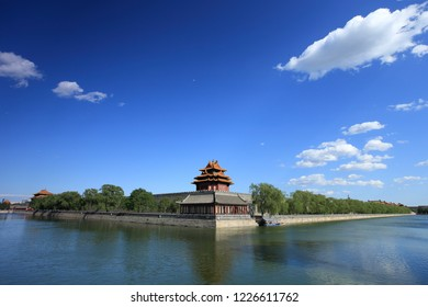 Beijing Forbidden City turret under blue sky and white clouds