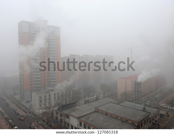 """BEIJING - JAN 12: Severe air pollution on January 12, 2013 in Beijing, China. Air quality index levels were classed as """"Beyond Index"""" (PM 2.5 of over 700 micrograms per cubic meter)."""