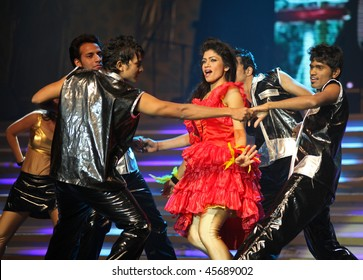 BEIJING - JANUARY 31: The Indian Bollywood Film Star Song and Dance Troupe perform on stage during Indian Music and Dance Show at Beijing Exhibition Theater on January 31, 2010 in Beijing, China.