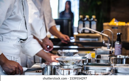 BEIJING, СHINA - JUNE 01, 2019: Traditional preparing food and professional Chinese cooks at kitchen.