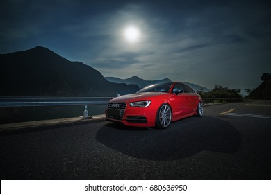 Beijing - June 8, 2017: Audi A3 on moonlit mountain road.