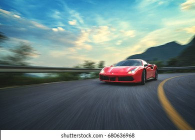 Beijing - June 8, 2017: Ferrari 488 GTB at speed on twisting mountain road. Illustrative editorial.