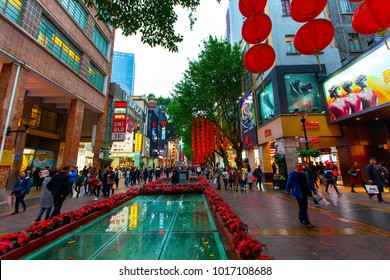 BEIJING LU, GUANGZHOU SHI, GUANGDONG, CHINA - JAN 2018: Busy Beijing Road street scene with a canopy of red lanterns and people shopping - Beijing Lu main shopping street, Guangzhou, China.