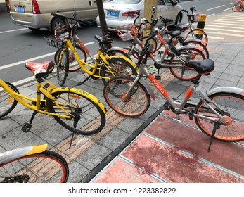 BEIJING LU, GUANGZHOU SHI, GUANGDONG CHINA - NOVEMBER 2018 : row of bicycles parked. Row of colorful bicycles. Rental yellow bicycles. Pattern of vintage bicycles bikes for rent on sidewalk.