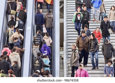 BEIJING - MARCH 10, 2012. Crowd on escalator and stairs in Beijing on March 10, 2012. With just over 1.3 billion people (1,339,724,852 as of 2010 census), China is the world's most populous country.