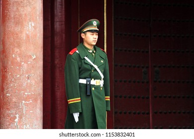 BEIJING - MARCH 11 2009: Chinese soldier guards inside the Forbidden City in Beijing, China. Military service in China is compulsory for all men who attain the age of 18.